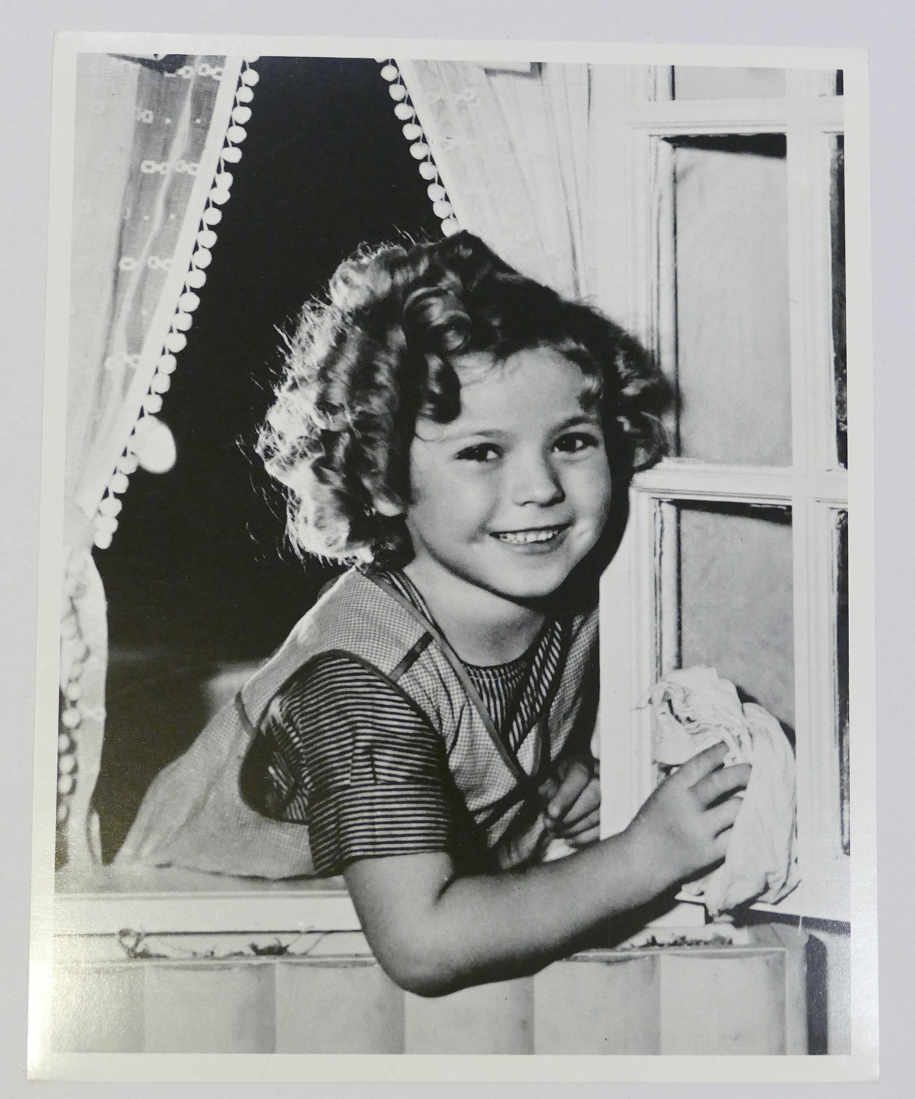 SHIRLEY TEMPLE PHOTO cleaning window