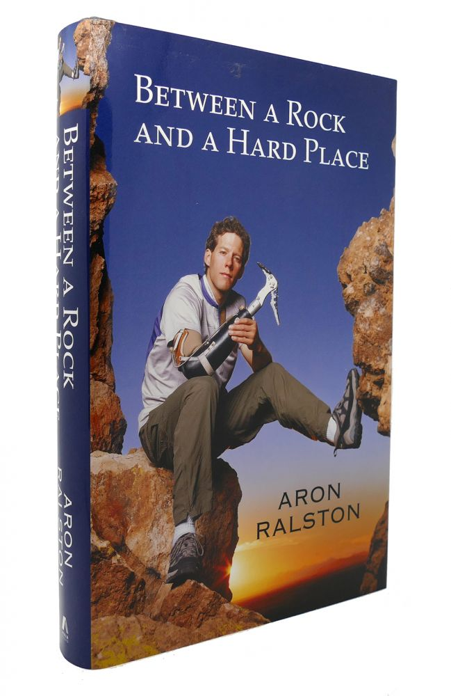 BETWEEN A ROCK AND A HARD PLACE. Aron Ralston.